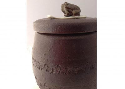 """The last Lily pad Series: Toad on phone with horses. Horses used to be in North America before humans.  They went extinct before humans, then humans brought them back.  Kazegama Ash fired Porcelain and Stoneware 12""""x 8"""""""