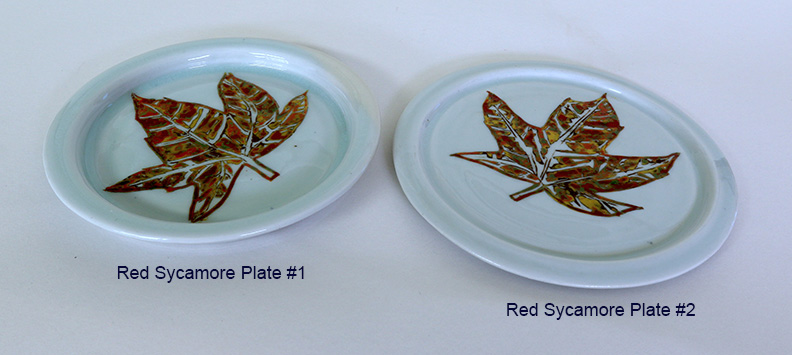 2 red sycamore plates